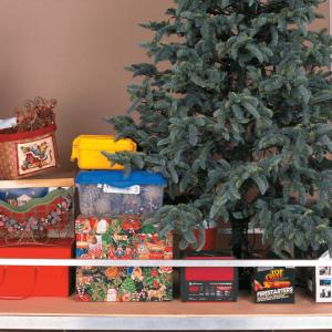 Woman-storing-items-in-attic-aladdin-storage-lift