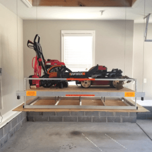 Attic lift with lawn mower
