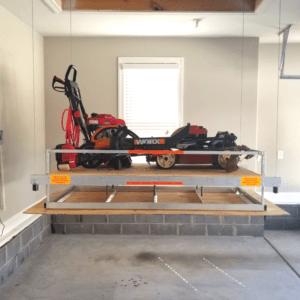 Lawn equipment on attic lift